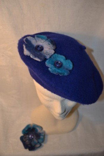Royal blue beret with hand felted floral trim
