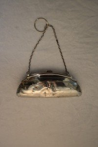 small silver purse with chain