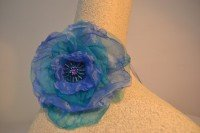 Turquoise and purple fascinator wrist corsage.