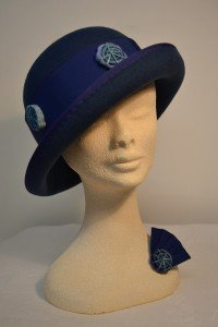 Decorative band for cloche hat and matching brooch