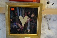 Souvineer wedding picture in red and gold hearts