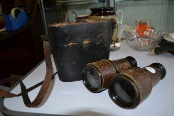 Binoculars with (broken) case